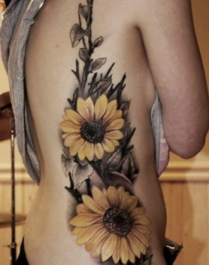 Beautiful sunflower tattoo... Would love something like this as a tribute to my grandparents :)