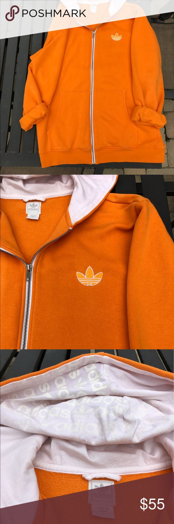 ADIDAS HOODIE Bright orange Adidas hoodie. With white writing in the hood that says adidas repeatedly. Super cute hoodie in perfect condition. Men's Large Adidas Shirts Sweatshirts & Hoodies