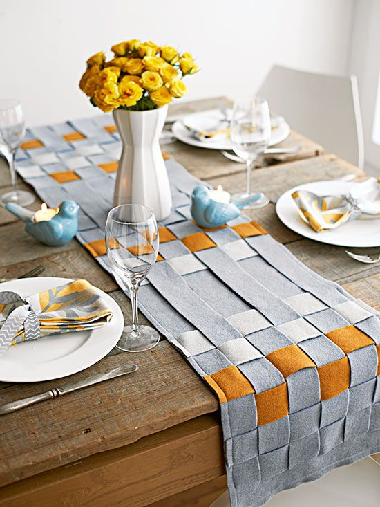 Felt doesn't fray. We took advantage of this property by weaving strips of felt for a clean-lined lattice table runner that's simpler than it looks. Step 1: Cut a 9-inch-wide piece of felt to your desired length and several 1-1/2x10-inch strips for your lattice. Mark lines with a disappearing-ink pen to the length of the runner 1-1/2 inches apart. Step 2: Using a crafts knife or a rotary cutter, cut strips in your runner along the lines, leaving a 1-1/2-inch uncut border at both ends.