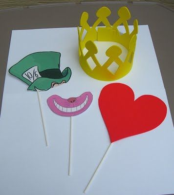 Make some props for your photo booth!  These are Alice in Wonderland, but you could make different ones depending on the theme of your party.