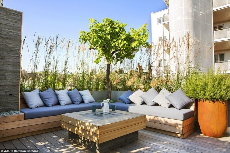 Among the most favoured outdoor spaces, is a roof terrace in London designed by Town and Country Gardens and Adolfo Harrison Gardens, which features wooden decking furnished with a wood-framed outdoor sofa and coffee table