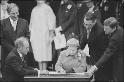 The Right Honourable Pierre Trudeau signs the Canadian Charter of Rights and Freedoms with Her Majesty Queen Elizabeth II, 1982