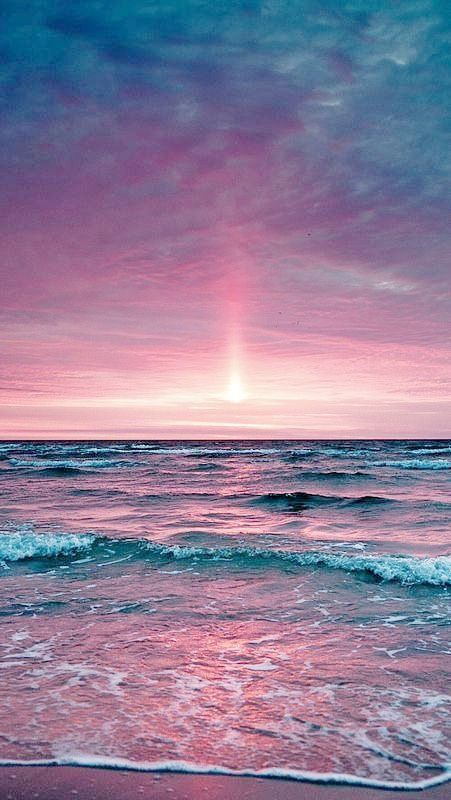 Rose pink sunset and blue and purple ocean colors.
