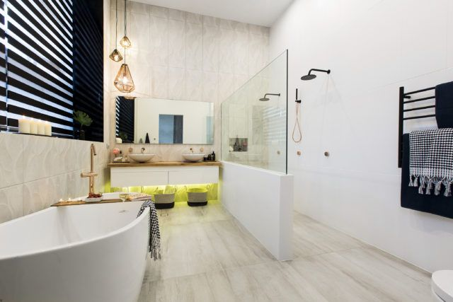 Huge bathroom with fantastic contrasts of neutrals and black.