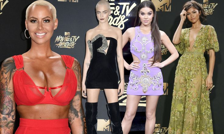 Amber Rose knows how to heat up the red carpet - rain, hail or shine. She flashed major skin in a crimson crop top with a matching skirt as a huge storm washed out the MTV Movie & TV Awards.