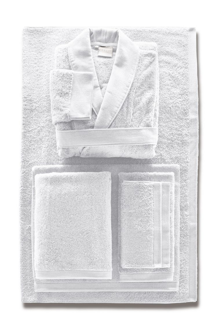 The highly textured Superb bath towel lends a substantial and well-defined elegance to any bathroom décor, and comes in gorgeous deep and natural colors. This plush terry bath towel's border features a raised dot pattern framed in thick trim; towel is finished in contrasting woven trim. 100% cotton. In ivory, khaki, ocean green, pearl gray, purple, Prussian blue, sapphire dark blue, and white. http://www.frette.com/bath/towels/superb-bath-towel#