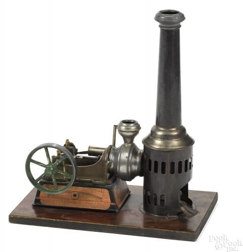 Krauss N. Moore hot air engine, single cylinder drive mounted on a decorative, faux brick - Price Estimate: $600 - $800