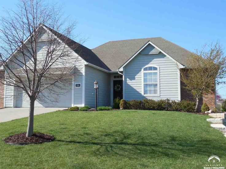 Spacious open floor plan with hardwoods in the kitchen, eating area and dining room. Wall of windows across the back living room into the sunroom. Additional 1/2 car garage space for storage. Basement finished in 2010 by Wedman Construction. Lot is one of the biggest in the neighborhood less than one block from the city limits and countryside. Seller offering $3,000 fence allowance. AHS home warranty included. #lawrence #kansas #lawrenceks #larrynorthrop