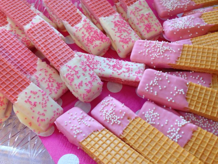 Pink and white chocolate dipped wafer cookies for Minnie Mouse themed sweets table