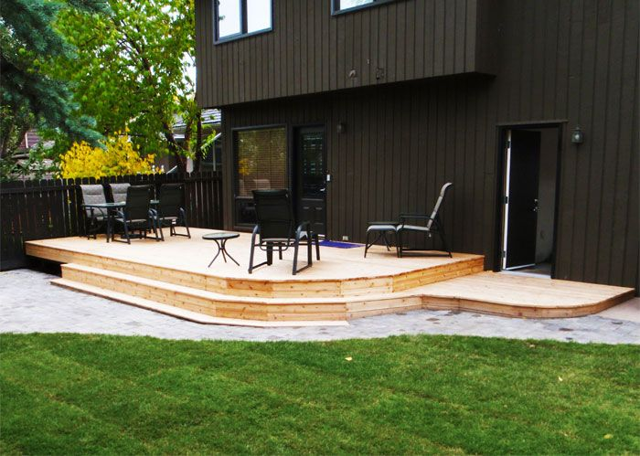 CREATE ESCAPE - Woodbine.  Cedar decking with wrap around steps to create an open feel to your yard. Lower paver stone patio for added guests or events.