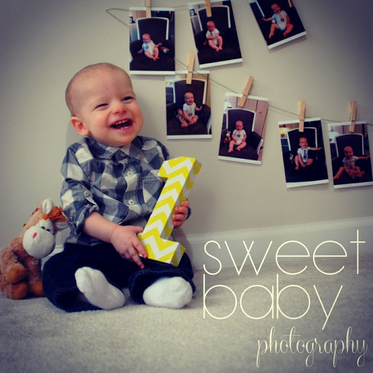 Baby boy photo session, one year pictures, 12 month pictures, holding number one, monthly pictures as backdrop, photo idea