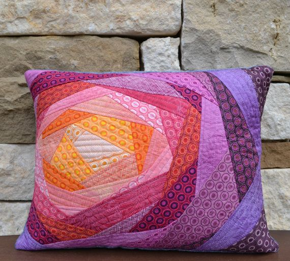 This pillow case was made using the quilt as you go method. Many different colored fabrics were used to give the effect of a flower opening up. Each