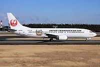 Japan Transocean Air (JP) Boeing 737-446 JA8996 aircraft, with the stickers ''Ryujin Mabuyer'' & ''UNICEF'' on the airframe, skating at Japan Tokyo Narita International Airport. 12/02/2012.
