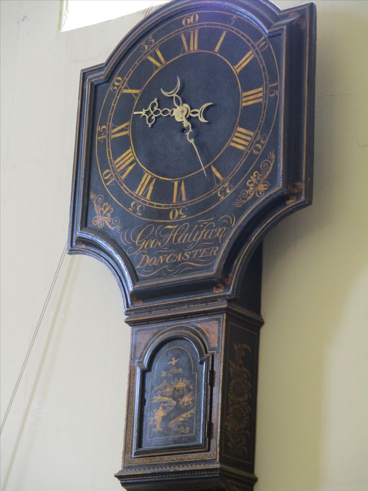Act of Parliament clock (also known as 'Tavern Clocks').  Maker: George Halifax, Doncaster (b.1725, d.1811).  In 1797 a tax was placed on all clocks and watches, resulting in people relying on clocks in public places such as taverns. The tax had such a devastating effect on the clock making trade that it was quickly repealed, but the name remained.  Located in the Georgian Kitchen, Culzean Castle.