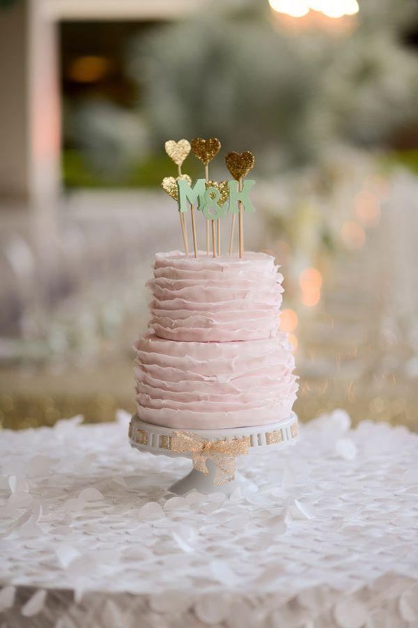 pink ruffles + heart-shaped toppers, photo by Katherine Stinnett http://ruffledblog.com/guanacaste-destination-wedding #weddingcake #cakes #ruffled