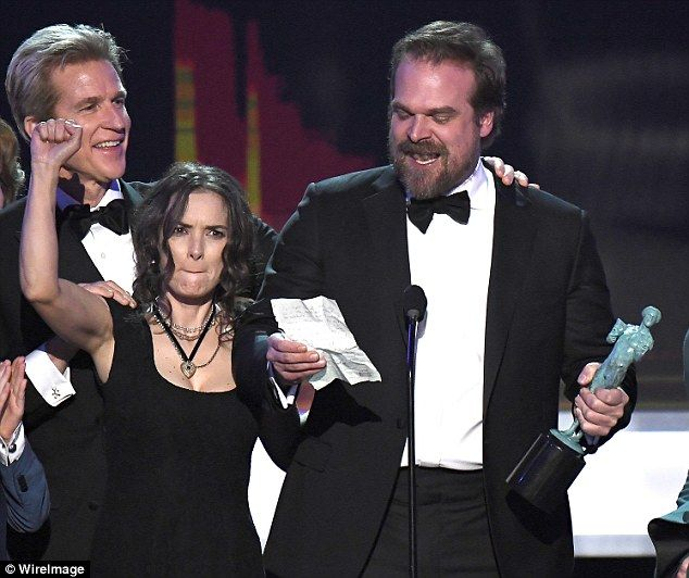 It's all in her face! Winona Ryder, left, sparked a meme frenzy as she reacts to David Harbour's powerful 'call to arms' political speech after Stranger Things SAGs win