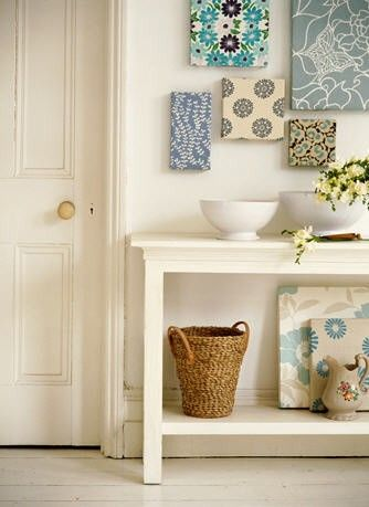 Wall Art: Shoe box lids, covered in fabric. Cheaper than canvas -