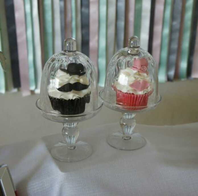 Lips and moustache feature cupcakes seafoam and pink ribbon backdrop
