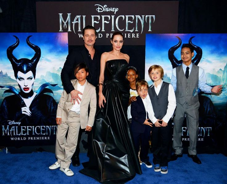 This is one stylish family. The Pitt-Jolie clan at the 'Maleficent' premiere: Angelina and Brad (center) with children (left to right) Pax Jolie-Pitt, Zahara Jolie-Pitt, Knox Jolie-Pitt, Shiloh Jolie-Pitt and Maddox Jolie-Pitt.