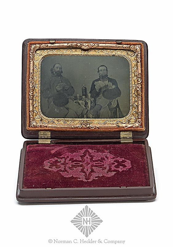 Antique Turner Brother Whiskey Bottle Related Tintype Photograph, early image of men sitting at a table with playing cards and a Turner Brothers whiskey bottle, America, 1860-1880. Rectangular fancy gutta percha case, reddish brown exterior, red velvet and brass interior, approximate ht. 4 inches, wdth. 5 inches. Rare with a recognizable early bottle. Fine condition. #Bottles #Whiskey #MADonC