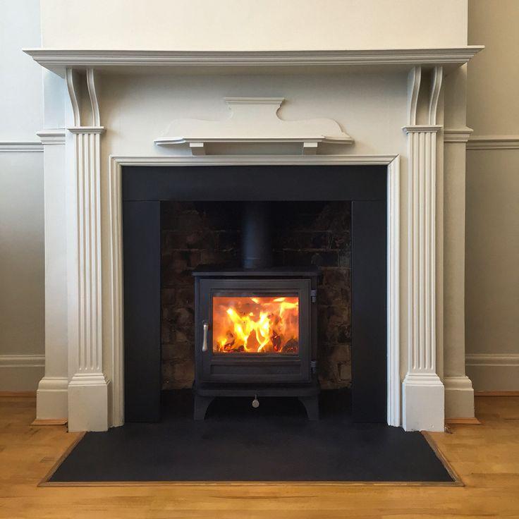 Wood burning stove installation with timber surround- Chesneys Salisbury 5kw wood burning stove - timber surround