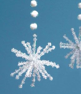 Snowflake decorations made with 6 pipe cleaners cut in half to make 12 pieces.  Use one piece to wrap tightly around the others and splay all the ends to make a snowflake shape.  Put about 5 clear beads onto each strand and thread pompoms onto fishing wire or thread to hang.