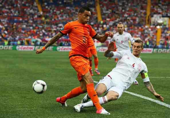 Denmark 1 Holland 0 in 2012 in Kharkiv. Daniel Agger makes a good tackle on Gregory van der Wiel in Group B at Euro 2012.