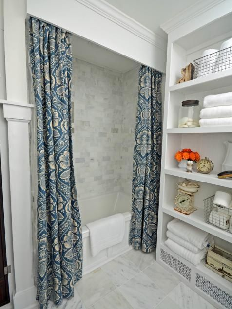 Tired of a ho-hum, store-bought shower curtain? Try dressing your shower with custom draperies and a wood cornice fit for a picture window.