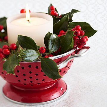 Christmas Colander  Make a charming table centerpiece with a colorful colander. Fill it with holiday greenery such as ivy leaves and berries. Insert a glass candleholder in the center and add a white unscented candle. Use a small colander to accent a cocktail table and a larger one for a dining table.