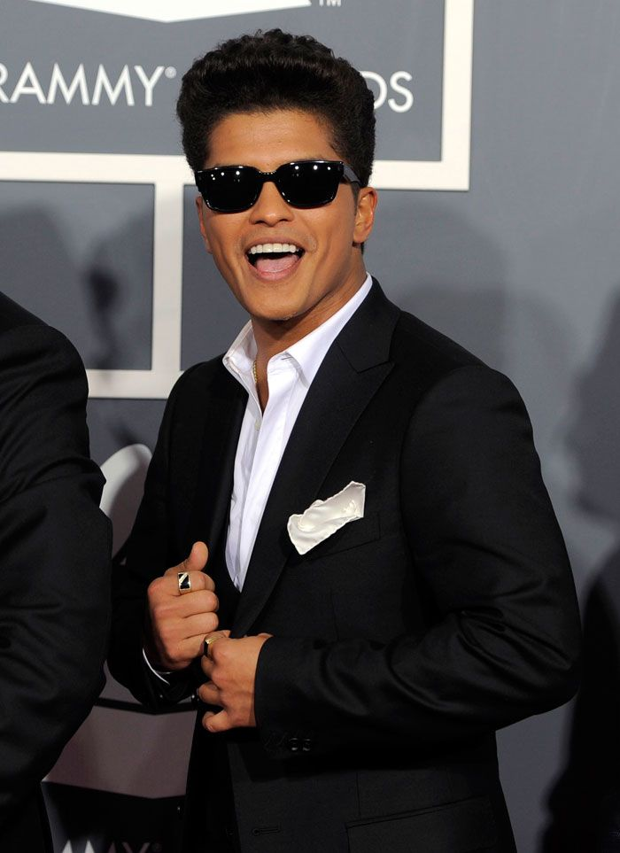 Bruno Mars. He is Unique and Cocky a TRUE Talent, Sexy as hell, Funny, Stylish, Great hair (luvin the curly fro), has dimples, big brown eyes, beautiful teeth and skin, my God the list just goes on and on PERFECTION, pure PERFECTION <3