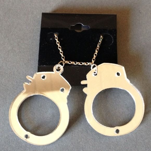 Mirror handcuff necklace Cute mirror handcuff necklace new never been worn. Jewelry Necklaces