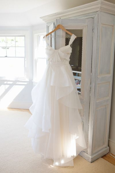 Ruffly Reem Acra wedding dress: http://www.stylemepretty.com/massachusetts-weddings/osterville/2013/10/29/classic-elegance-in-osterville-from-sweet-monday-photography/ | Photography: Sweet Monday - http://sweetmondayphotography.com/