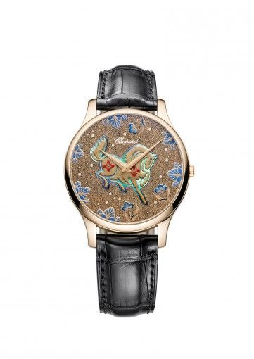 "Special dial to celebrate the year of the horse for Chinese New year. Chopard Watches L.U.C XP Urushi  18-carat rose gold Proclaimed a ""Living National Treasure"" by the Japanese authorities, artist Kiichiro Masumura has created this unique dial for Chopard based on the time-honoured lacquering techniques of Urushi and Maki-e. Marrying ancestral craftsmanship with the highest degree of Swiss watchmaking, this majestic work of art portrays the Chinese..."