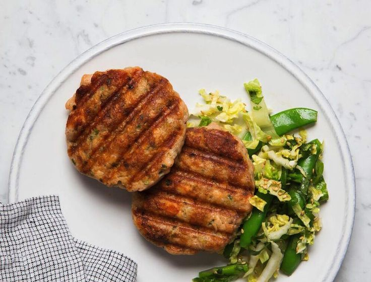 These Asian-infused salmon burgers are a new favorite around the office. If you're not detoxing, make three large burgers and serve them on brioche buns with sriracha mayo.