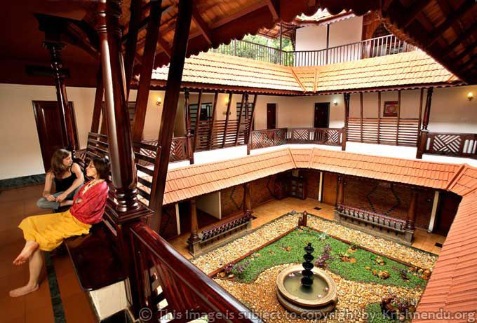 Naalukettu a courtyard is created within the four for Indian traditional house plans
