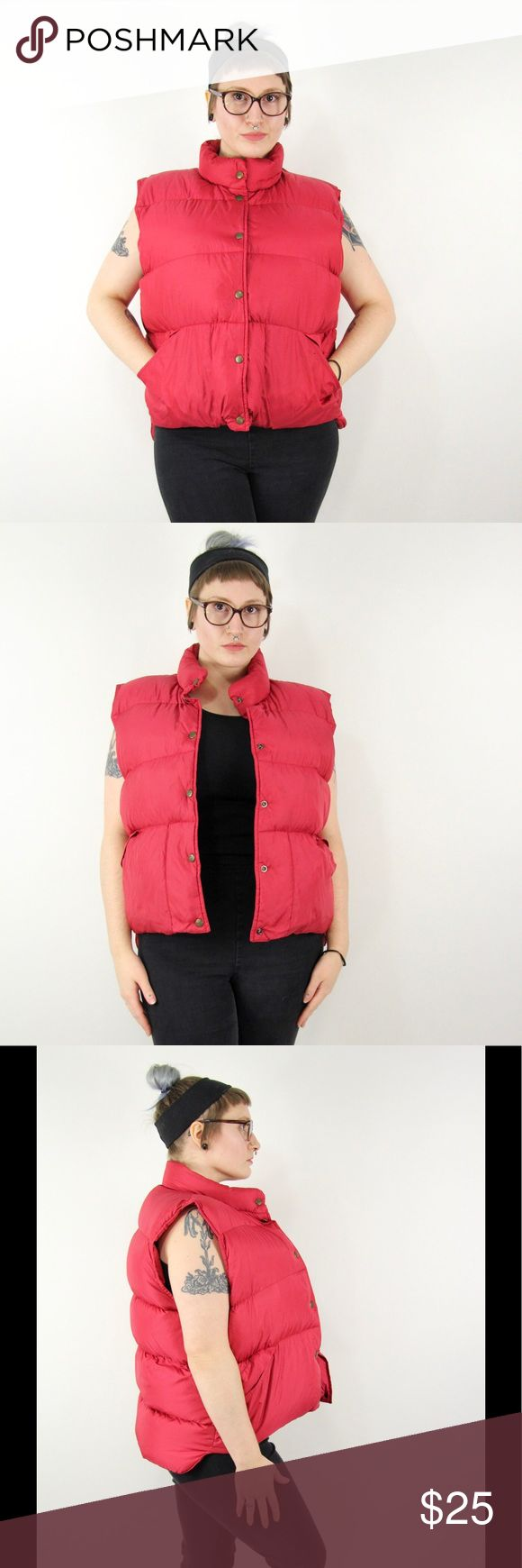 """90s Vintage LL Bean Down Puffer Vest Ski Jacket 90s vintage LL Bean red puffer vest with snap front closure and side slit pockets. No content label, but the exterior feels like a lightweight nylon and the insulation is a super fluffy down.   Size: n/a, fits like Women's Large, Men's Medium  Length: 25"""" back, 22"""" front  Chest: 50""""  Waist: 48""""   — Condition —  Small (1/4"""") tear on front left shoulder. Needs a stick or two to close it up. Otherwise good condition. L.L. Bean Jackets & Coats…"""