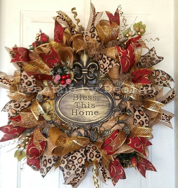 This beautiful rod iron sign is on layers of burlap and gold mesh. It has 5 kinds of ribbon with glitter grapes and crystal fruit and gold curly