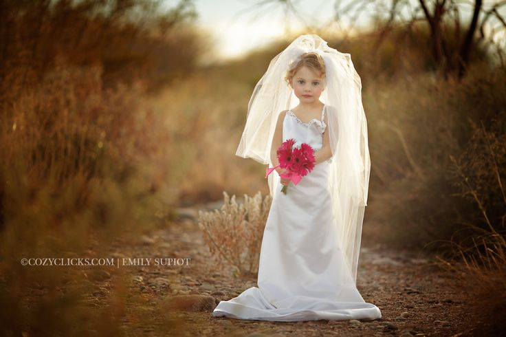 Little girl in moms wedding dress photo. Phoneix children and family photographer.  Wedding dress up.