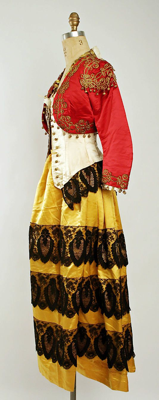 """""""Gypsy"""" fancy dress costume, French, ca. 1880. Label: """"Maison E. Devaus / 18 rue des Pyramides / Paris"""" Worn with red cap, belt, and cuffs, all with coins sewn to them."""