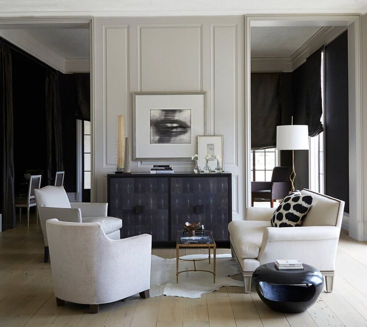 Classic and modern by A column & obelisk on the Bureau add to the vignettte in this cool space! BetsyBrown - desire to inspire - desiretoinspire.net