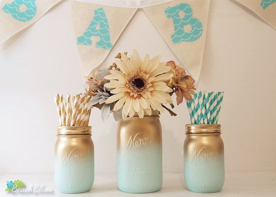 ***PLEASE READ SHOP ANNOUNCEMENT FOR TURNAROUND TIME***  These adorable mason jars are ideal for baby showers, birthdays and nurseries. They are painted on the outside only, so you can use fresh flowers and water.  This listing is 3 jars for $22. All 3 jars are painted gold and aqua. The pint jars are 5 tall and the quart jar is 6 3/4 tall. All jars come with gold lids.  **THIS IS AN ORIGINAL BEACH BLUES BABY DESIGN** As of September 2015, no other Etsy shop has this design.  You can find…