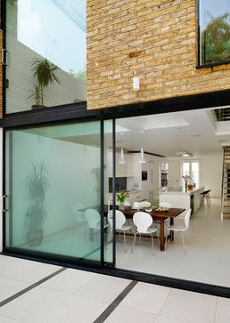 Clean lines, minimalist framing on the glazing, continuity of inside and out. Presumably no chance of double height?
