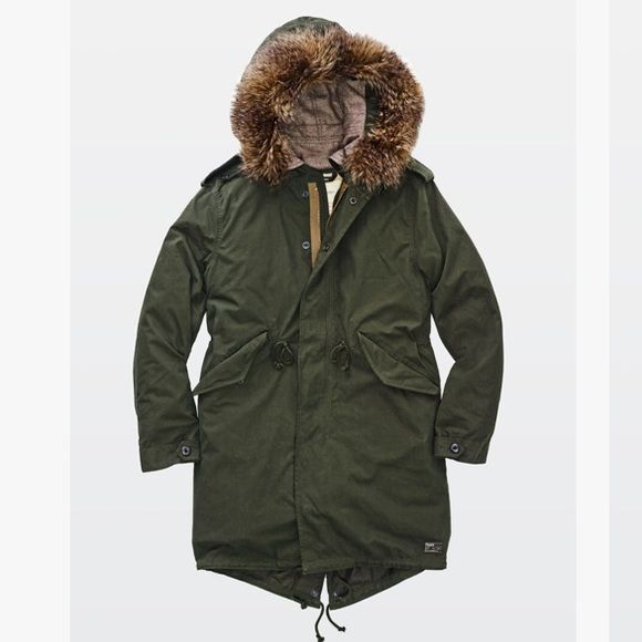 Aritzia Britannia Parka Military-inspired, this durable twill parka is designed with shoulder epaulettes, as well as an interior drawcord at the waist and hem that can be adjusted. The parka has a poly-filled quilted liner that can be worn on its own as an anorak. A faux fur trim and drawcord on the hood help keep the cold out. Classic Fit, fits true to size. Selling on Mercari only, do not buy via Posh. Aritzia Jackets & Coats