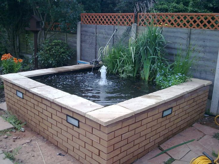 24 best images about ponds and water features on pinterest for Raised koi fish pond
