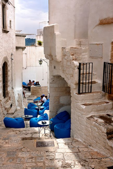 Polignano a mare e dintorni The white city of Ostuni, Puglia, South Italy. The #blue #chairs are beautifully striking!