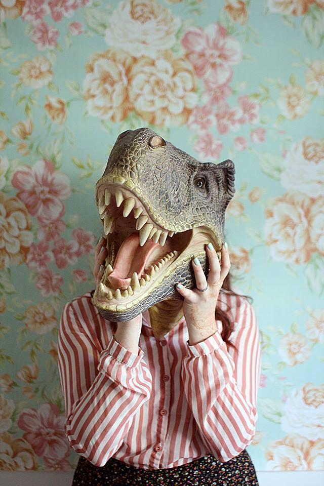 Dinosaur head, floral wallpaper.