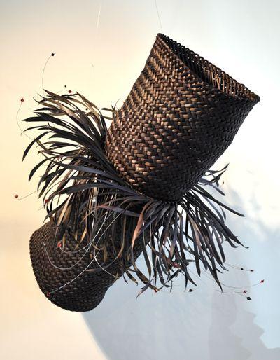"Jess Paraone is a contemporary Maori weaver: "" Whiringa 2""  harakeke with swarovski crystals"