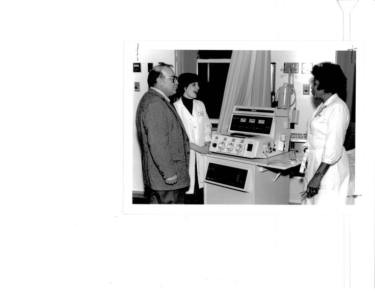 Staff Nurse Michelle Geraghty (center) explains the peritoneal dialysis procedure to Sante  Breda, service coordinator (left), and Ethel Briggs, evening nursing supervisor (right), 1983.