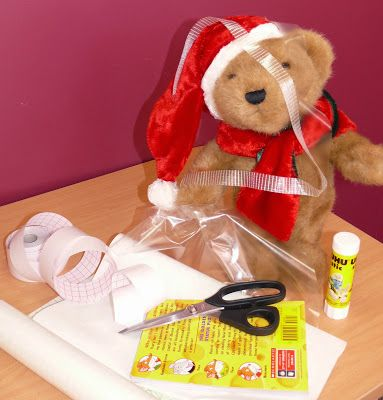 Christmas Adventures of Bing the Library Bear #6. Bing covers a book.