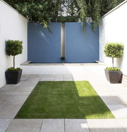 Small courtyard, with pond, fountain & bold dash of color